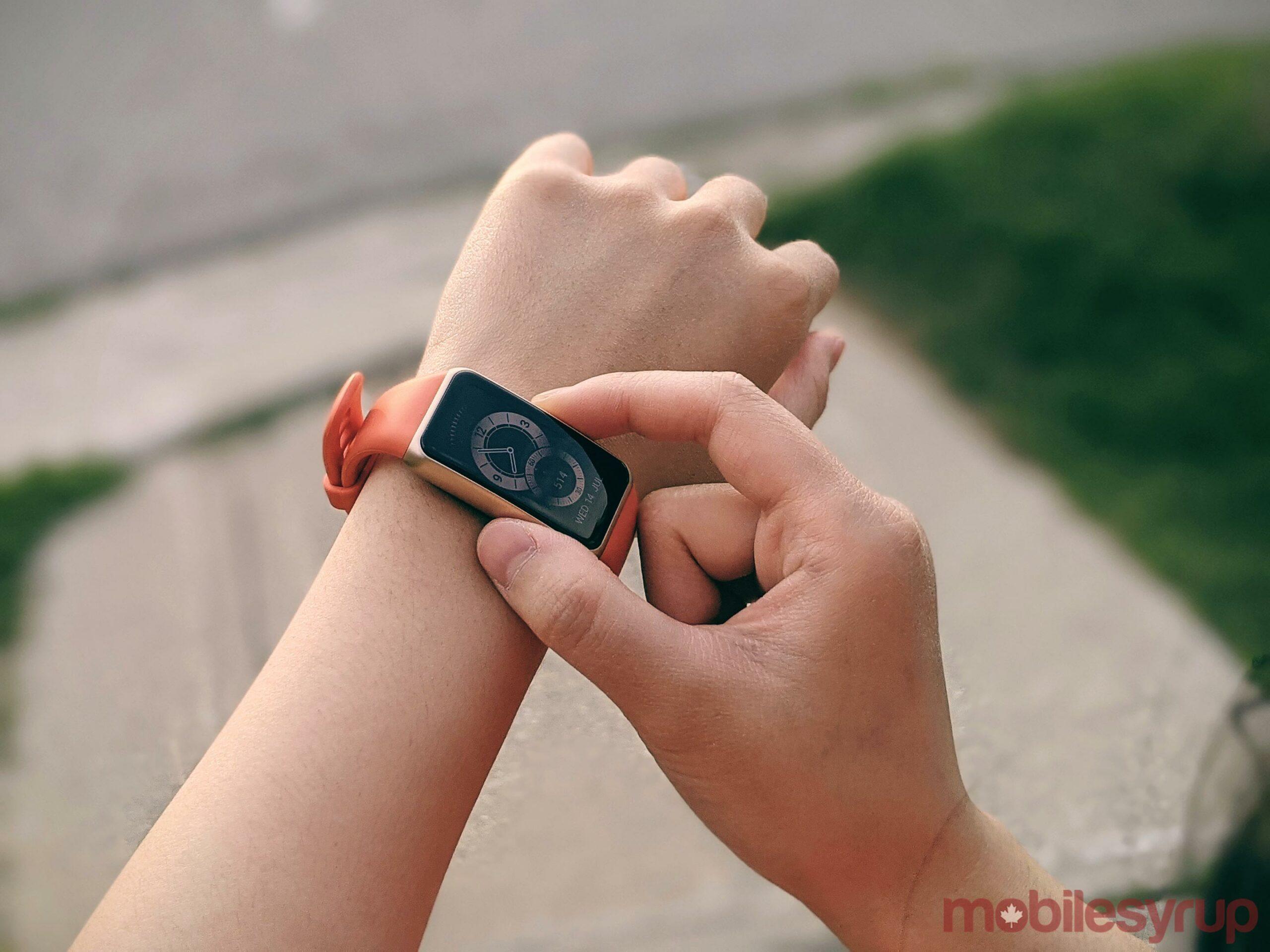 Huawei Band 6 on wrist outdoors
